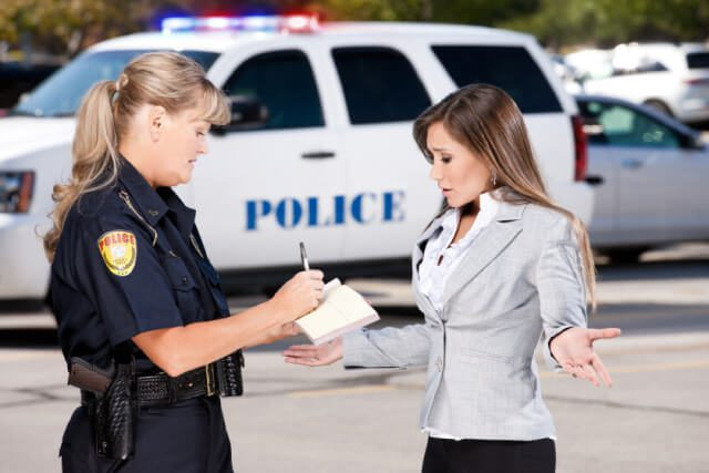 a woman speaking to a police officer in indianapolis about obtaining a u-visa